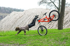 A young male extreme falls from a bicycle. Stock Photography