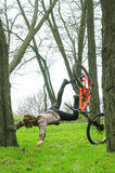 A young male extreme falls from a bicycle. Royalty Free Stock Images
