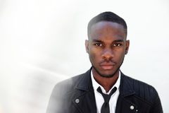 Young male fashion model in leather jacket and tie Royalty Free Stock Photos