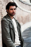 Young male fashion street on wall Royalty Free Stock Photography