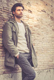 Young male fashion street on wall Royalty Free Stock Photos