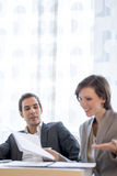 Young Male and Female Business People in Corporate Attire Discus Stock Photo