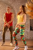 Male and female dancers dancing. Young male and female dancers dancing indoor Royalty Free Stock Photography