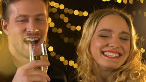 Young male and female drinking champagne and laughing, having good time at party. Stock footage stock video footage