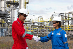 Young male and female engineer hand shake. Royalty Free Stock Images