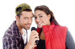 Young male and female singer with microphone. On an isolated background Royalty Free Stock Image