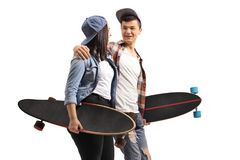 Young male and female skaters with longboards talking to each other stock photography