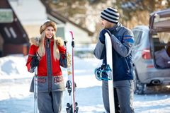 Male and female skiers looking in love on mountain ready for ski. Young male and female skiers looking in love on mountain ready for skiing Stock Photo
