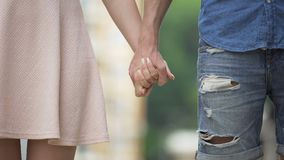 Young male and female taking each other by hand and letting go, saying good bye stock footage
