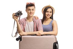 Young male and female tourists with a suitcase and a camera. Isolated on white background royalty free stock image