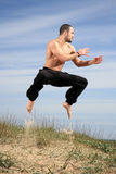 Young male fighter exercise outdoor Stock Image