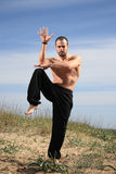Young male fighter exercise outdoor Stock Images