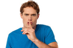 Young male with finger on his lips Royalty Free Stock Photo