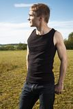 Young male with fitness body posing confidently Royalty Free Stock Image