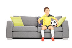 Young male football fan sitting on couch Royalty Free Stock Photography