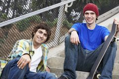 Young Male Friends With Skateboard Stock Photography