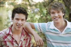 Young Male Friends Smiling Royalty Free Stock Images