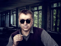 Young male with funny sunglasses on a stick Royalty Free Stock Images