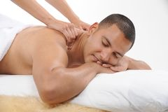 Young male getting massage royalty free stock photo