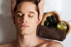Young male getting spa treatment. Royalty Free Stock Photos