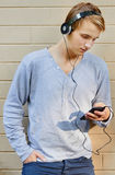 Young male going through song list Royalty Free Stock Image