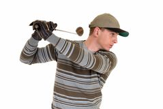 Young male golfer. Trendy looking young male golfer, studio shot, reflective surface Royalty Free Stock Image