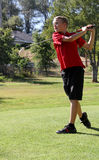 Young male golfer driving Royalty Free Stock Photos