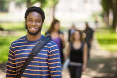 Young Male Grad Student Smiling On Campus Stock Image
