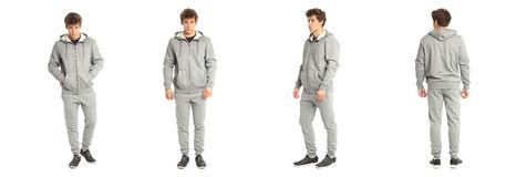 Young male with in the gray sportswear isolated Stock Image