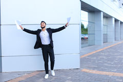 Young male guy arab businessman laughing, rejoices success, hold Stock Photography