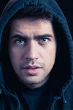 Young male hacker in hoody Stock Photos