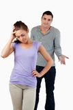 Young male has no clue how to calm his girlfriend. Against a white background Stock Images