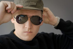 Young male with hat and sunglasses Royalty Free Stock Photo