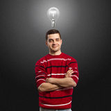 Young male have got an idea. And smiles on camera Royalty Free Stock Photography