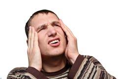 Young male having headache Stock Photos