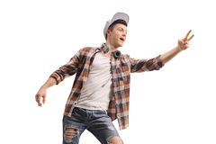 Young male with headphones making a peace sign stock photo