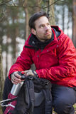 Young male hiker with backpack in forest Royalty Free Stock Photography