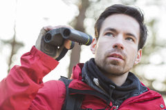 Young male hiker with binoculars in forest Stock Photos