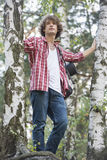 Young male hiker standing in forest Royalty Free Stock Photography
