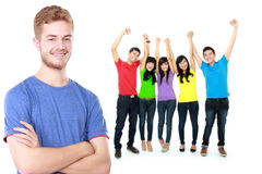 Young male with his friend raised arm at the background Stock Photos