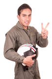 Young male hispanic pilot holding helmet Royalty Free Stock Images