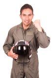 Young male hispanic pilot holding helmet Royalty Free Stock Photos