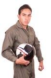 Young male hispanic pilot holding helmet Stock Photos