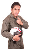 Young male hispanic pilot holding helmet Stock Image