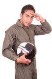 Young male hispanic pilot holding helmet Royalty Free Stock Photography