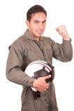 Young male hispanic pilot holding helmet Stock Photo