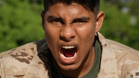 Latino Male Soldier And Anger Royalty Free Stock Photography