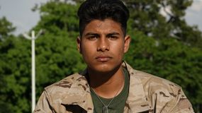 Unemotional Young Male Soldier Stock Photo