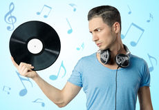 Young male holding black vinyl in hand Stock Image