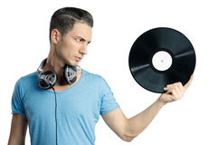 Young male holding black vinyl in hand Stock Photo